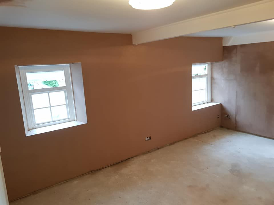 Plastering around window frames